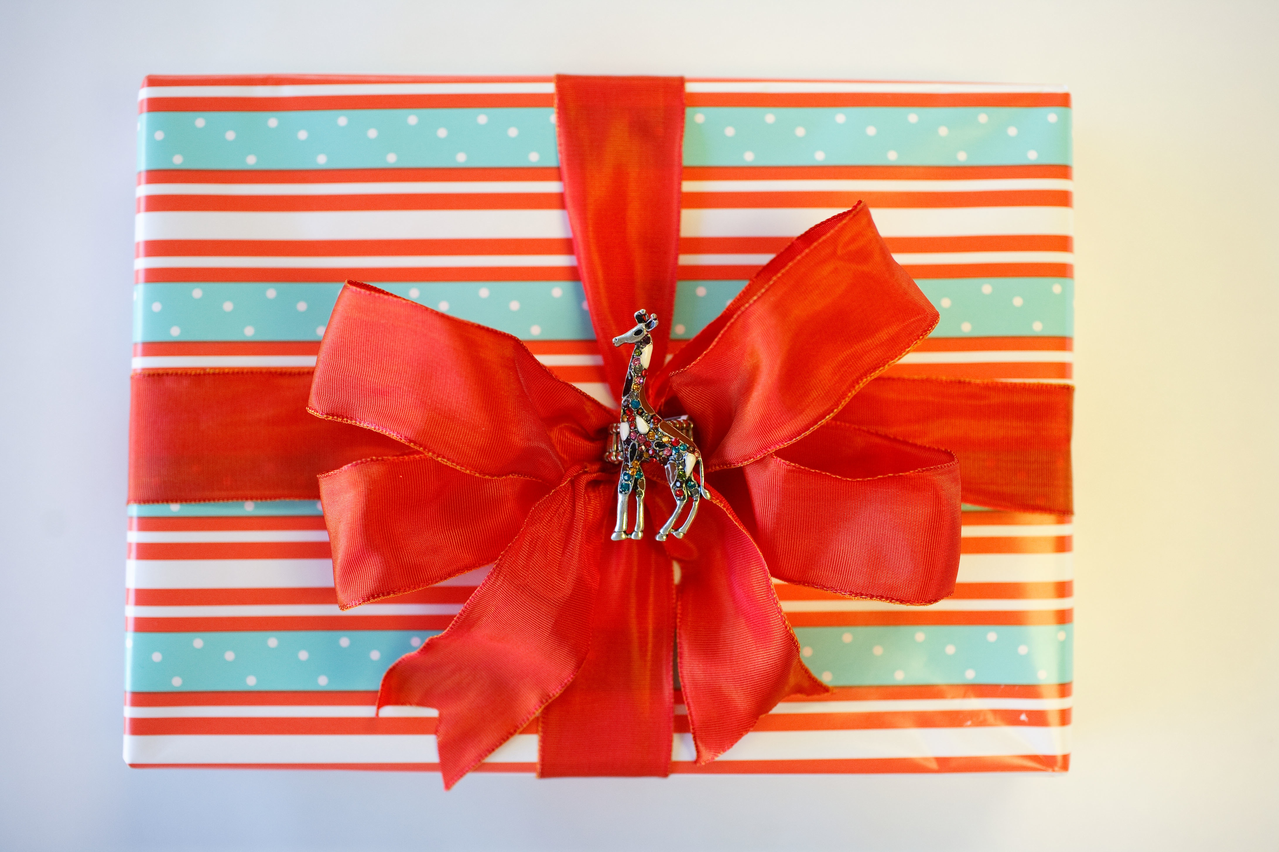 Striped Giftwrap with Orange bow and giraffe detail